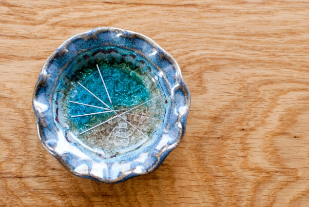 Acupuncture needles on blue dish